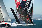 Oracle Team USA digs the bows in and capsizes at the first mark in the first fleet race of day four of the America's Cup World Series, San Francisco. 6/10/2012
