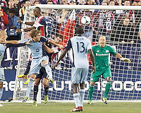 Corner kick. Sporting Kansas City defender Chance Myers (7), New England Revolution midfielder Andy Dorman (12), and New England Revolution goalkeeper Matt Reis (1). In the first game of two-game aggregate total goals Major League Soccer (MLS) Eastern Conference Semifinal series, New England Revolution (dark blue) vs Sporting Kansas City (light blue), 2-1, at Gillette Stadium on November 2, 2013.