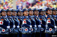 Military nurses look from atop a truck towards Chinese President and other leaders during the military parade marking the 70th anniversary of the end of World War Two, in Beijing, China, September 3, 2015. REUTERS/Damir Sagolj