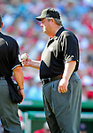 29 August 2010: MLB Umpire Joe West discusses a play during a game between the Washington Nationals and the St. Louis Cardinals at Nationals Park in Washington, DC. The Nationals defeated the Cards 4-2 to take the final game of their 4-game series. Mandatory Credit: Ed Wolfstein Photo