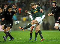 Wynand Olivier clears under pressure from Ma'a Nonu. Investec Tri-Nations - All Blacks v South Africa at Westpac Stadium, Wellington on Saturday 17 July 2010. Photo: Dave Lintott/lintottphoto.co.nz