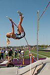 Idaho Statesman photojournalist, Shawn Raecke (lower left), photographs Eagle junior Allison Jeffries during the 5A Idaho Track and Field Championships on May 18, 2012 at Rocky Mountain High School, Meridian, Idaho. Jeffries defended her state title with a vault of 12-00.