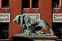 General view at sunrise of the statue called Lion tuant une chevre or Lion et mouflon (Lion killing a goat), created by Paul Jouve circa 1937 and located in front of the Art Deco Fauverie (the big cats building) built by Rene Berger, in the Menagerie of Jardin des Plantes, Paris, 5th arrondissement, France. The bronze statue of the Lion tuant une chevre was cast by the Fonderie Rudier, a foundry created in 1792 and also producing Auguste Rodin, Aristide Maillol and Antoine Bourdelle master pieces. Founded in 1794 by Jacques Henri Bernardin de Saint-Pierre, the Menagerie of Jardin des Plantes became the largest exotic animal collection in Europe in the 19th century and is the second oldest public zoo in the world. Picture by Manuel Cohen