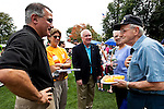 09/25/2011 - Medford/Somerville, Mass. - Tufts President Tony Monaco, left, and Medford Mayor Michael McGlynn, center, met attendees at Tufts University's Community Day on Sunday, September 25, 2011. (Jodi Hilton for Tufts University)