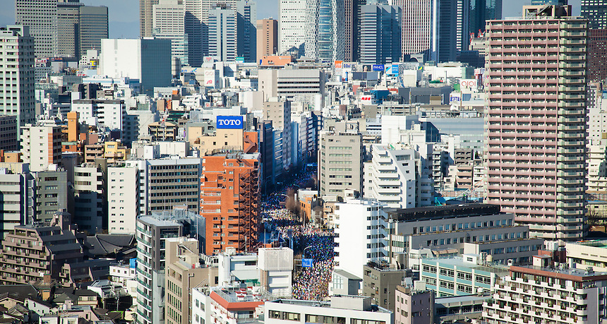 Aerial view of Tokyo Metropolis on a sunny day including thousands of runners taking part in the Tokyo Marathon 2013.