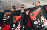 "Moenia pop music band members, Alejandro Ortega (L), Jorge Soto and Alfonso Pichardo (R) pose to photographers as they arrive at a press conference, March 28, 2006. Moenia received  a golden award after selling 50 thousand copies of their last CD ""Hits Live"". Photo by © Javier Rodriguez/"