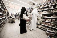 Qatar - Doha -  Qatari couple shopping at Carrefour in City Center Mall
