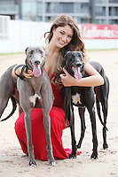 NO REPRO FEE. 2/8/2011. Pictured today was new Miss Universe Ireland, Aoife Hannon, and champion greyhounds Feetonfire (black) and Kaiser in Shelbourne Park, Dublin who were on hand for the first trap draw to launch the richest greyhound race in the world, The Ladbrokes.com Irish Greyhound Derby. TheLadbrokes.com Irish Greyhound Derby offers a massive prize fund of EUR225,000, and is run over a distance of 550yds and takes place in Shelbourne Park on Saturday 10th September with qualifying rounds beginning on 3rd August 2011.  The Trap Draw takes place to determine the race and trap for each greyhound entered in to the eagerly anticipated Derby, and with 150 dogs due to take part this years competition is gearing up to be one of the most exciting in the history of the sport. Picture James Horan/Collins