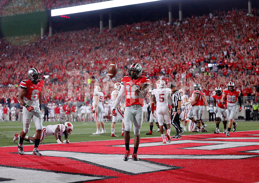 Ohio State Buckeyes wide receiver Philly Brown (10) flips the ball after catching a touchdown pass during the second half of the game between Ohio State and Wisconsin at Ohio Stadium on Saturday, September 28, 2013. (Columbus Dispatch photo by Jonathan Quilter)
