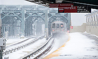 "A subway train departs the Smith Street-9th Street station on the elevated portion of the IND line in the Gowanus neighborhood of Brooklyn in New York during a snow storm on Tuesday, January 21, 2014. The city is expected to receive between 8 and 14 inches of snow with brutal ""Polar Express"" temperatures in the single digits. The snow will taper off by Wednesday morning but the arctic temperatures are expected to last several days.  (© Richard B. Levine)"