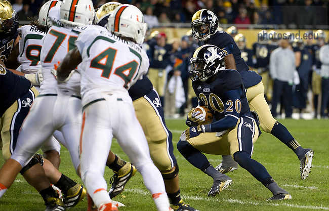 Oct. 6, 2012; Running back Cierre Wood drives to the end zone for a third quarter touchdown against Miami during the Shamrock Series at Soldier Field in Chicago. Photo by Barbara Johnston/University of Notre Dame..