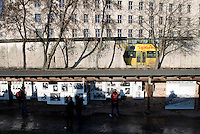 A sightseeing bus passes remains of the Berlin Wall next to the Topography of Terror museum, an outdoor museum located in Niederkirchnerstrasse, formerly Prinz-Albrecht-Strasse, on the site of buildings which during the Nazi regime were the headquarters of the Gestapo and the SS.