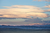 Stacked lenticular clouds over the Absaroka Mountains