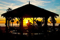 Musician Tom Recchia plays the guitar at Crescent Bay Gazebo amid the sunset on Sunday, November 14, 2010.