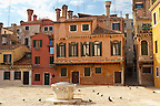 Square off Calle Fonte with well and venetian chimneys - Venice Italy