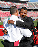Ohio State Buckeyes head coach Urban Meyer  hugs Ohio State Buckeyes quarterback Braxton Miller (5) before the Ohio State football season opener against Buffalo at Ohio Stadium in Columbus, Saturday afternoon, August 31, 2013. (Columbus Dispatch  / Eamon Queeney)