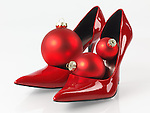 Christmas ornament in red sexy high heel womens shoes isolated on white background