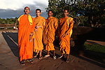 Young Buddhist monks pose for a photograph at Angkor Wat, Cambodia. June 8, 2013.