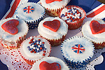 "Party food home made ""cup cakes"" decorated with red hearts and Union Jack English flags. Prince William Kate Middleton Princess Catherine Royal Wedding Street Party. Barnes London UK. 29 April 2011"