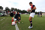 17 August 2013: Robbie Shaw (USA) ties his shoe before warming up with Mike Petri (USA) (right). The United States Men's National Rugby Team played the Canada Men's Nationa Rugby Team at Blackbaud Stadium in Charleston, South Carolina in the first leg of their 2015 Rugby World Cup Qualifying Series. Canada won the game 27-9.