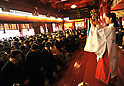 January 4, 2012, Tokyo, Japan - A Shinto shrine maiden gives God's blessing to a group of business persons on the traditional first business day in 2012 at Kanda Shrine in downtown Tokyo on Wednesday, January 4, 2012. Thousands of people turned out to celebrate the new year and make their wishes in a traditional rite at the Shinto shrine which dates back 1,270 years. (Photo by Natsuki Sakai/AFLO) [3615] -mis-