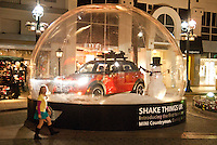 A giant snow globe features the new 2011 Mini Cooper Countryman at the Third Street Promenade on Monday, December 13, 2010. The Countryman is the first with four-doors and all-wheel drive Mini Cooper. It will be available next month.