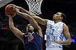 02 February 2015: North Carolina's Brice Johnson (11) blocks a shot by Virginia's Malcolm Brogdon (15). The University of North Carolina Tar Heels played the University of Virginia Cavaliers in an NCAA Division I Men's basketball game at the Dean E. Smith Center in Chapel Hill, North Carolina. Virginia won the game 75-64.