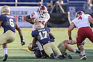 Annapolis, MD - December 3, 2016: Navy Midshipmen cornerback Tyris Wooten (17) tackles Temple Owls running back Ryquell Armstead (25) during game between Temple and Navy at  Navy-Marine Corps Memorial Stadium in Annapolis, MD.   (Photo by Elliott Brown/Media Images International)