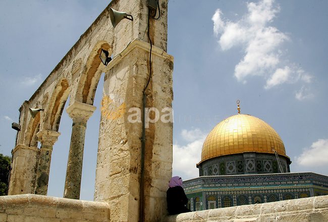 Palestinian Muslim woman sits in front of the Dome of Rock after Friday prayers in the Al Aqsa Mosque compound, also known to Jews as the Temple Mount, in Jerusalem's old city on May 28, 2010. Photo by Mahfouz Abu Turk