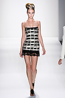 Model walks runway an EBONY+ IVORY ETROCOTTON JACQUARD STRAPLESS MINI DRESS.BORDERED W/ FRENCH LACE + VELVET RIBBON by Zang Toi, for the Zang Toi Spring 2012 My Dream Of North Africa Collection, during Mercedes-Benz Fashion Week Spring 2012.