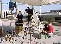 CNN journalist Brent Sadler doing a stand up report from the roof of  Baghdad press center 1998