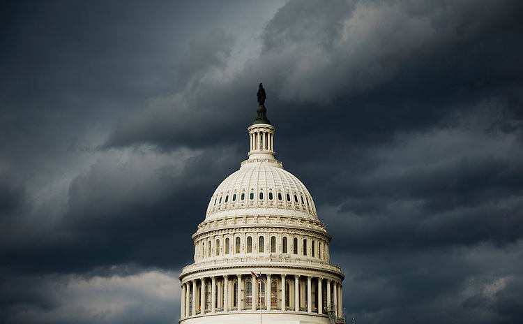 UNITED STATES - JULY 8: A strong storm front passes over the U.S. Capitol on Tuesday, July 8, 2014. (Photo By Bill Clark/CQ Roll Call)