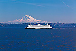 A mariner's view of the Seattle skyline with Mount Rainier for a backdrop with a Washington State Ferry in the foreground and the Space Needle, visible on the right horizon.