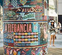 "Detail of ""FAILE: Wishing on You"" in Times Square in New York on Monday, August 17, 2015. The installation which reimagines Asian prayer  wheels using designs inspired by Times Square history is by the artist collaboration FAILE, Patrick McNeil and Patrick Miller. The public sculpture will be on display until September 1 and runs concurrent with FAILE's exhibition at the Brooklyn Museum. (© Richard B. Levine)"