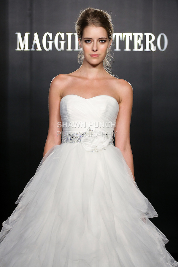 Model walks the runway in a Carissa Haute Couture wedding dress from the Maggie Sottero Bridal Spring 2012 collection, during  Couture: New York Bridal Fashion Week 2012
