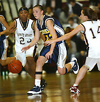 WATERBURY, CT,  02 JANUARY 2006, 010207BZ13- Kennedy's Amber Alberto (23) drives through the defense of Sacred Heart's Chanel Ward (23) and Kelsey Dunn (14)  during their game at Sacred Heart High School in Waterbury Tuesday.<br /> Jamison C. Bazinet Republican-American