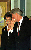 United States President Bill Clinton shares a secret with Lieutenant Governor Kathleen Kennedy Townsend (Democrat of Maryland) as they arrive at Pine Crest Elementary School in Silver Spring, Maryland for a School Modernization Event on September 8, 1998.<br /> Credit: Ron Sachs / CNP