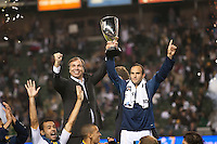 CARSON, CA - November 6, 2011: LA Galaxy head coach Bruce Arena and midfielder Landon Donovan hoist the Western Conference Championship Cup after the match between LA Galaxy and Real Salt Lake at the Home Depot Center in Carson, California. Final score LA Galaxy 3, Real Salt Lake 1.