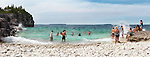 People swimming in Georgian Bay, Bruce Peninsula national park, Ontario, Canada, panoramic summertime scenery