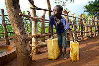 Olio village, Earnest, age 8 fetches water a few times a day from less than a mile away. His village Water to Thrive well is now a blessing as water is safe to drink and the risk of dysentery or worse is gone. He proudly wears a slingshot around his neck that he made.