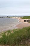 Locals walk on the beach in summer,  Ludington, Michigan, USA