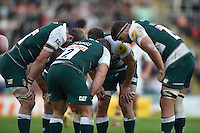 Leicester Tigers forwards huddle together during a break in play. Aviva Premiership match, between Leicester Tigers and Wasps on November 1, 2015 at Welford Road in Leicester, England. Photo by: Patrick Khachfe / Onside Images