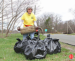 Torrington, CT-042013MK030 Barbara Morris, from Torrington, a volunteer during the Annual Earth Day cleanup, collects debris along the exit 43 on-ramp to Route 8 on Saturday morning. Kim Barbieri, event coordinator, said that over one-hundred volunteers, of all ages, participated in the annual cleanup this year. Michael Kabelka / Republican-American.