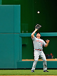 12 April 2012: Cincinnati Reds outfielder Jay Bruce pulls in a fly ball during play against the Washington Nationals at Nationals Park in Washington, DC. The Nationals defeated the Reds 3-2 in 10 innings to take the first game of their 4-game series. Mandatory Credit: Ed Wolfstein Photo