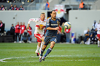 Landon Donovan (10) of the Los Angeles Galaxy is trailed by Tim Ream (5) of the New York Red Bulls during the 1st leg of the Major League Soccer (MLS) Western Conference Semifinals at Red Bull Arena in Harrison, NJ, on October 30, 2011.