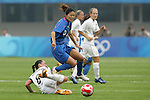 06 August 2008: Homare Sawa (JPN) (10) tries to avoid the tackle of Hayley Moorwood (NZL) (8).  The women's Olympic team of New Zealand tied the women's Olympic soccer team of Japan 2-2 at Qinhuangdao Olympic Center Stadium in Qinhuangdao, China in a Group G round-robin match in the Women's Olympic Football competition.