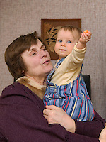 Happy Caucasian Elderly Senior Grandmother Holding Kid Baby