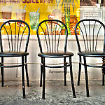 HDR of three black chairs on Chinatown's streets, Manhattan, New York City.