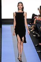 Ming walks runway in a carbon black crepe cocktail dress with back banded straps, by Monique Lhuillier, from the Monique Lhuillier Spring 2012 collection fashion show, during Mercedes-Benz Fashion Week Spring 2012.