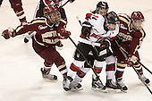 Blake Bolden (BC - 10), Claire Santostefano (NU - 13), Casey Pickett (NU - 14), Emily Field (BC - 15) - The Northeastern University Huskies defeated Boston College Eagles 4-3 to repeat as Beanpot champions on Tuesday, February 12, 2013, at Matthews Arena in Boston, Massachusetts.
